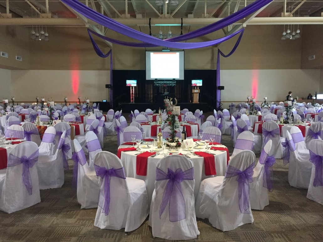 Meeting Room or Ballroom Setup with Table and Chairs - Tule and table covers in white, red, and purple.
