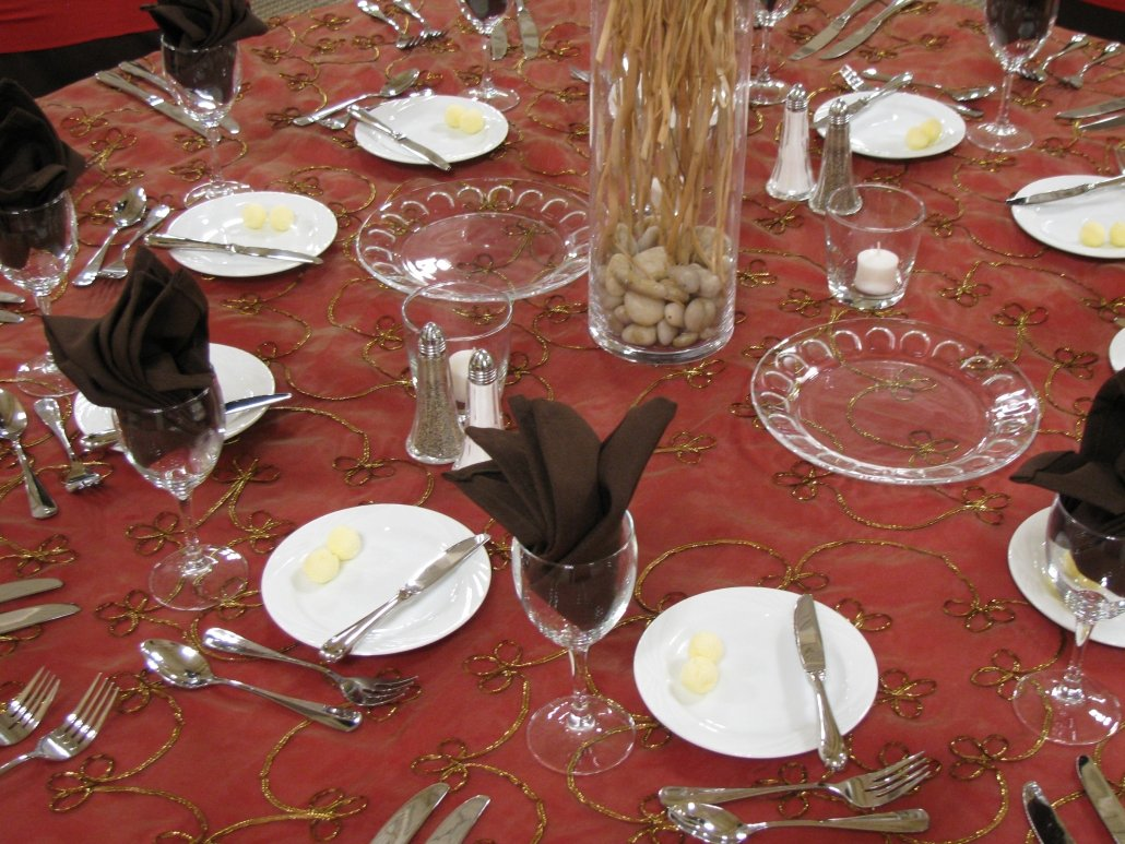 Elegantly set table - glassware, crystal plates, center piece